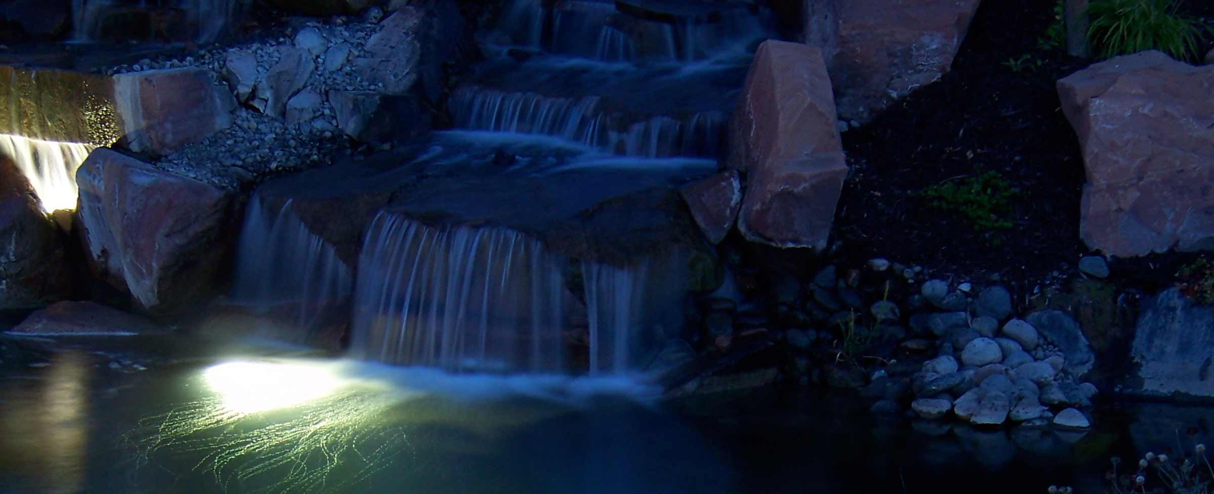 Waterfall and pond with lighting
