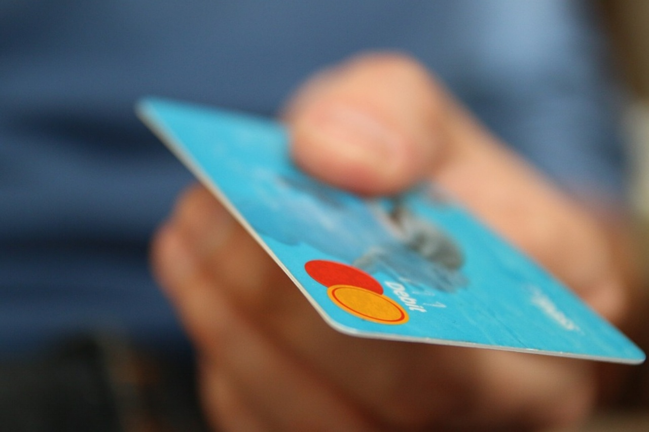 a shopper handing over a credit card