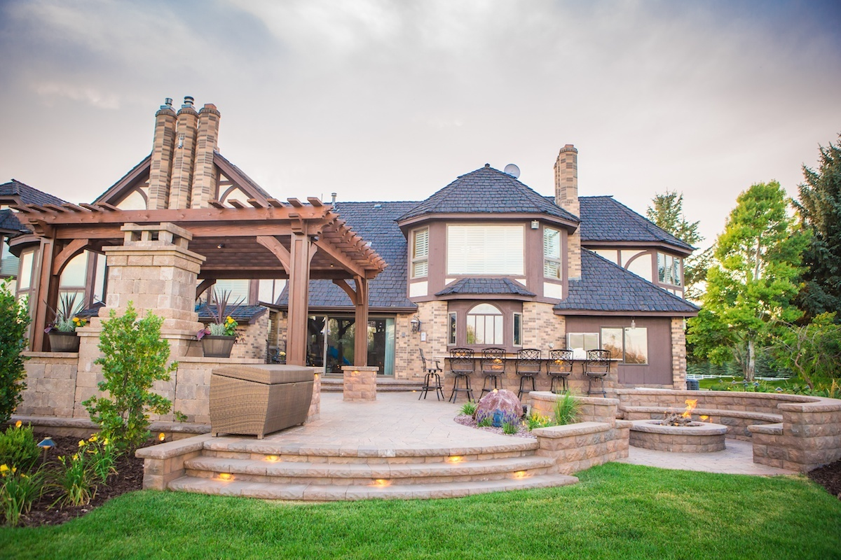 Paver patio and fire pit in Idaho Falls - How Much Does Residential Landscape Design Cost In Idaho Falls?